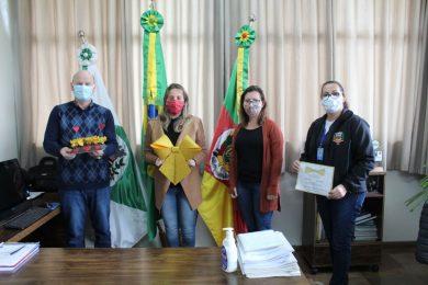 Equipe da secretaria divulga campanha para o prefeito Cláudio Alflen